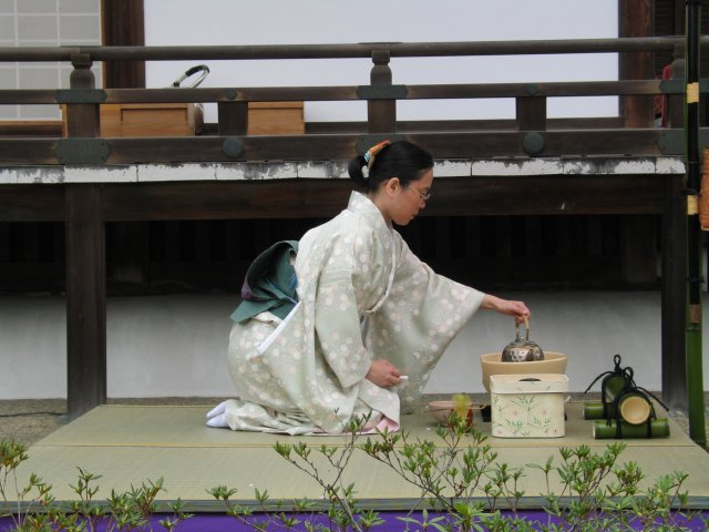 Kimono clad woman performing a Japanese tea ceremony